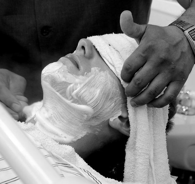 man getting his face shaved