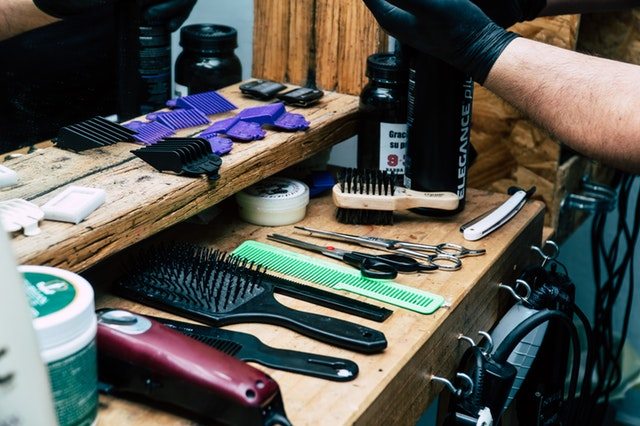a table with barber's shaving tools